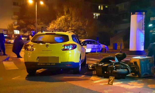 Horrorbaleset Budapesten: Fejjel csapódott a taxinak a motoros ételfutár, a férfi nem élte túl az ütközést